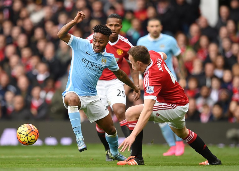 Manchester United's English defender Phil Jones (R) challenges Manchester City's English midfielder Raheem Sterling during the English Premier League football match between Manchester United and Manchester City at Old Trafford in Manchester, north west England, on October 25, 2015.  AFP PHOTO / PAUL ELLIS RESTRICTED TO EDITORIAL USE. No use with unauthorized audio, video, data, fixture lists, club/league logos or 'live' services. Online in-match use limited to 75 images, no video emulation. No use in betting, games or single club/league/player publications.